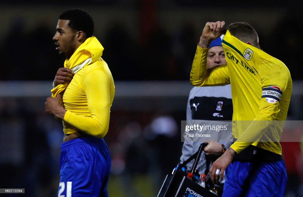 Carl Baker (R) and Cyrus Christie of Coventry react at full time of the Johnstone's Paint Trophy Northern Section Final Second Leg match between Crewe Alexandra and Coventry City at the Alexandra Stadium on February 20, 2013 in Crewe, England.