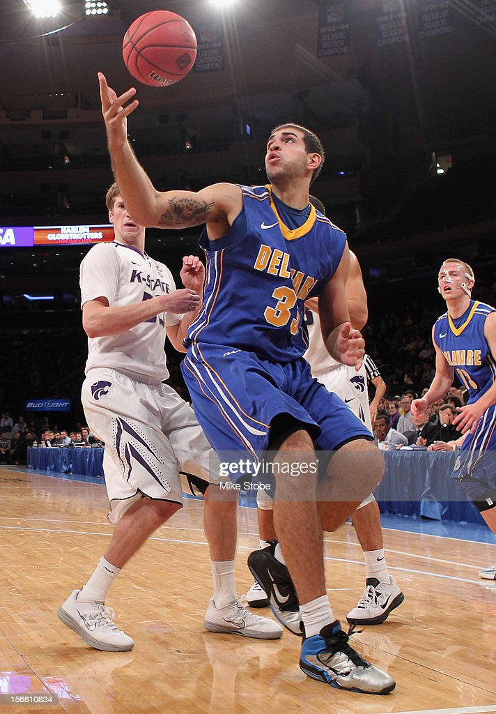 Carl Baptiste #33 of the Delaware Fightin Blue Hens looks for the loose ball against the Kansas State Wildcats during the NIT Season Tip-Off at Madison Square Garden on November 21, 2012 in New York City.