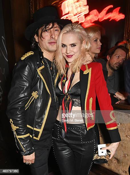Carl Barat and Edie Langley attend the NME Awards after party at Cuckoo Club on February 18 2015 in London England