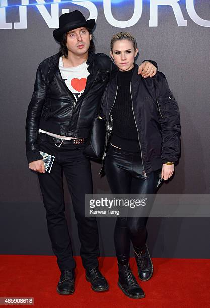 Carl Barat and Edie Langley attend the World Premiere of 'Insurgent' at Odeon Leicester Square on March 11 2015 in London England