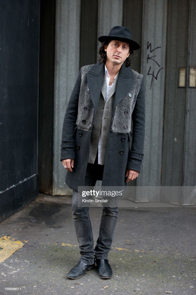 Carl Barat musician wearing Burberry shoes and jacket, a hat from Brazil, H and M jeans and a J Lindberg shirt on day 2 of London Mens Fashion Week Autumn/Winter 2013, on January 08, 2013 in London, England.