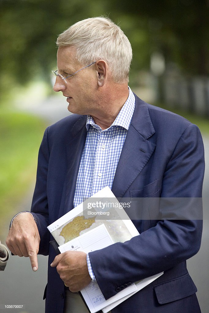 <a gi-track='captionPersonalityLinkClicked' href=/galleries/search?phrase=Carl+Bildt&family=editorial&specificpeople=3972090 ng-click='$event.stopPropagation()'>Carl Bildt</a>, Sweden's foreign minister, chats to colleagues before an annual budget meeting in Harpsund, Sweden, on Friday, Aug. 20, 2010. Sweden's ruling coalition extended its lead over the opposition less than four weeks before general elections after the government raised the economic outlook and said joblessness will be lower than previously estimated. Photographer: Linus Hook/Bloomberg via Getty Images