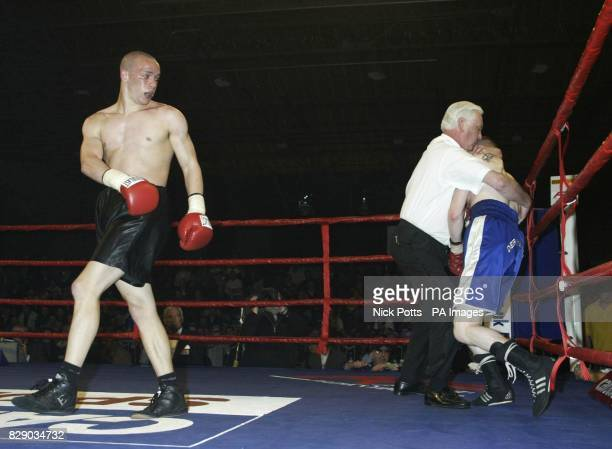 Carl 'Bo' Johanneson from Leeds stops Scotland's Andrew Ferrans in the 6th round during WBF World Super Featherweight Championship at Whitchurch...