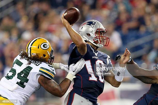 Carl Bradford of the Green Bay Packers hits Jimmy Garoppolo of the New England Patriots as he attempts a pass in the third quarter during a preseason...