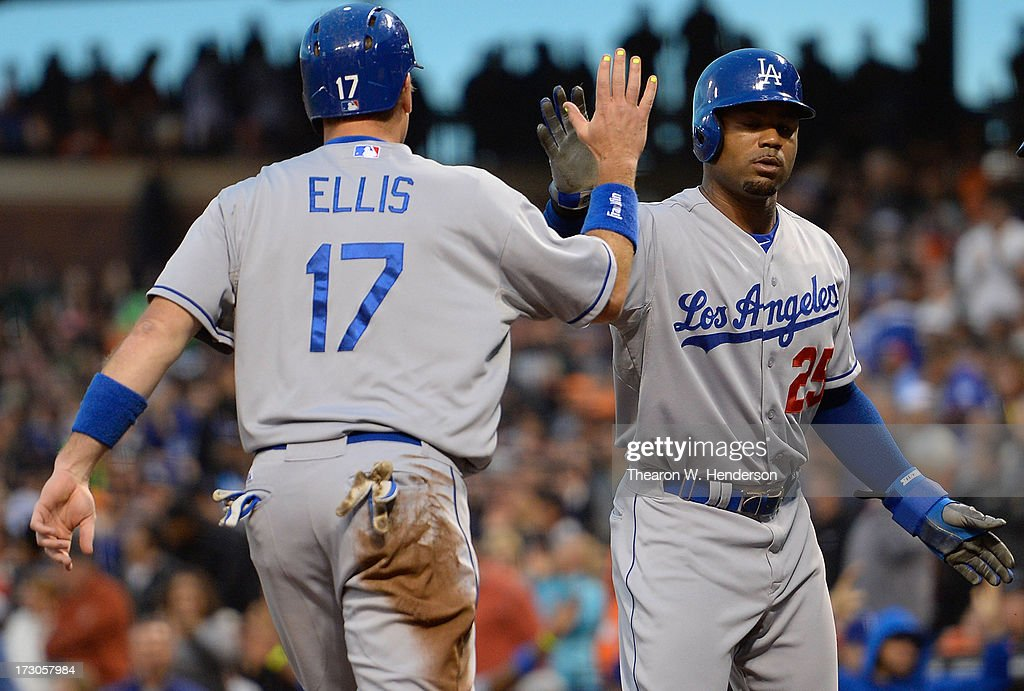 <a gi-track='captionPersonalityLinkClicked' href=/galleries/search?phrase=Carl+Crawford&family=editorial&specificpeople=208074 ng-click='$event.stopPropagation()'>Carl Crawford</a> #25 and A.J. Ellis #17 of the Los Angeles Dodgers celebrate after they both scored on a bases loaded triple from Juan Uribe #5 in the third inning against the San Francisco Giants at AT&T Park on July 5, 2013 in San Francisco, California.