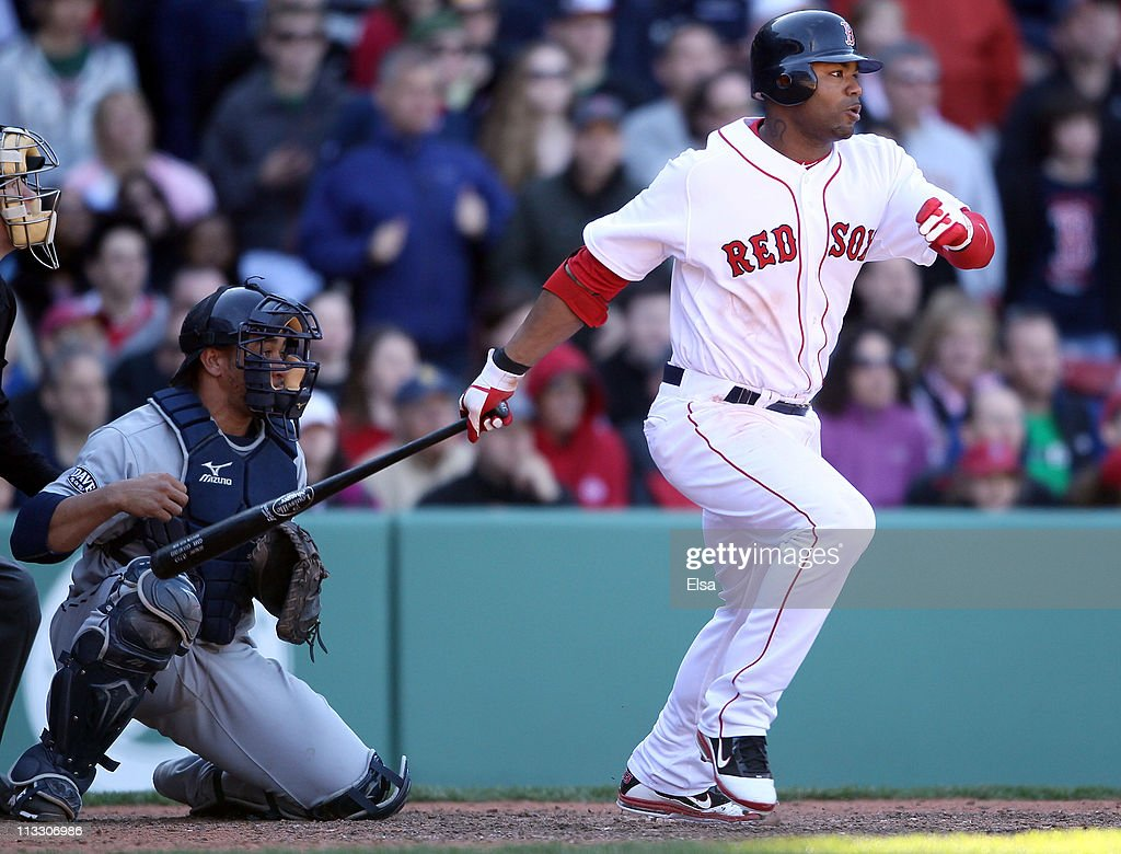 <a gi-track='captionPersonalityLinkClicked' href=/galleries/search?phrase=Carl+Crawford&family=editorial&specificpeople=208074 ng-click='$event.stopPropagation()'>Carl Crawford</a> #13 of the Boston Red Sox drives in the game winning run as <a gi-track='captionPersonalityLinkClicked' href=/galleries/search?phrase=Miguel+Olivo&family=editorial&specificpeople=209185 ng-click='$event.stopPropagation()'>Miguel Olivo</a> #30 of the Seattle Mariners defends on May 1, 2011 at Fenway Park in Boston, Massachusetts. The Boston Red Sox defeated the Seattle Mariners 3-2.