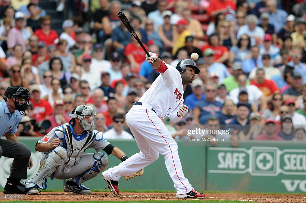 <a gi-track='captionPersonalityLinkClicked' href=/galleries/search?phrase=Carl+Crawford&family=editorial&specificpeople=208074 ng-click='$event.stopPropagation()'>Carl Crawford</a> #13 of the Boston Red Sox fouls off a pitch in the second inning against the Toronto Blue Jays at Fenway Park on September 14, 2011 in Boston, Massachusetts.