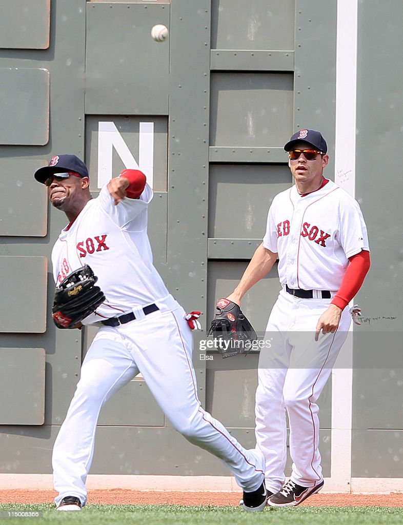 <a gi-track='captionPersonalityLinkClicked' href=/galleries/search?phrase=Carl+Crawford&family=editorial&specificpeople=208074 ng-click='$event.stopPropagation()'>Carl Crawford</a> #13 of the Boston Red Sox holds the runner at second as teammate <a gi-track='captionPersonalityLinkClicked' href=/galleries/search?phrase=Jacoby+Ellsbury&family=editorial&specificpeople=4172583 ng-click='$event.stopPropagation()'>Jacoby Ellsbury</a> #2 stands by on June 1, 2011 at Fenway Park in Boston, Massachusetts. The Chicago White Sox defeated the Boston Red Sox 7-4.