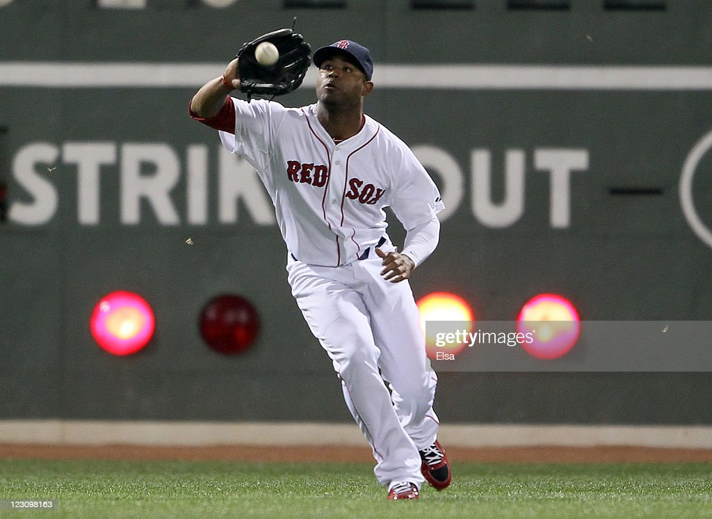 <a gi-track='captionPersonalityLinkClicked' href=/galleries/search?phrase=Carl+Crawford&family=editorial&specificpeople=208074 ng-click='$event.stopPropagation()'>Carl Crawford</a> #13 of the Boston Red Sox makes the catch for the out against the New York Yankees on August 30, 2011 at Fenway Park in Boston, Massachusetts.