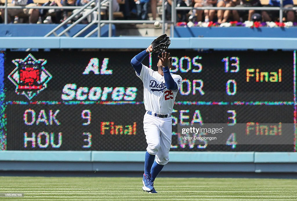 <a gi-track='captionPersonalityLinkClicked' href=/galleries/search?phrase=Carl+Crawford&family=editorial&specificpeople=208074 ng-click='$event.stopPropagation()'>Carl Crawford</a> #25 of the Los Angeles Dodgers catches a flyball hit to left field by Starling Marte #6 of the Pittsburgh Pirates (not in photo) for the second out in the fifth inning during the MLB game at Dodger Stadium on April 7, 2013 in Los Angeles, California. The Dodgers defeated the Pirates 6-2.