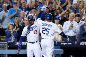 Carl Crawford of the Los Angeles Dodgers celebrates with Hanley Ramirez after Crawford hits a first inning home run against the Atlanta Braves in...