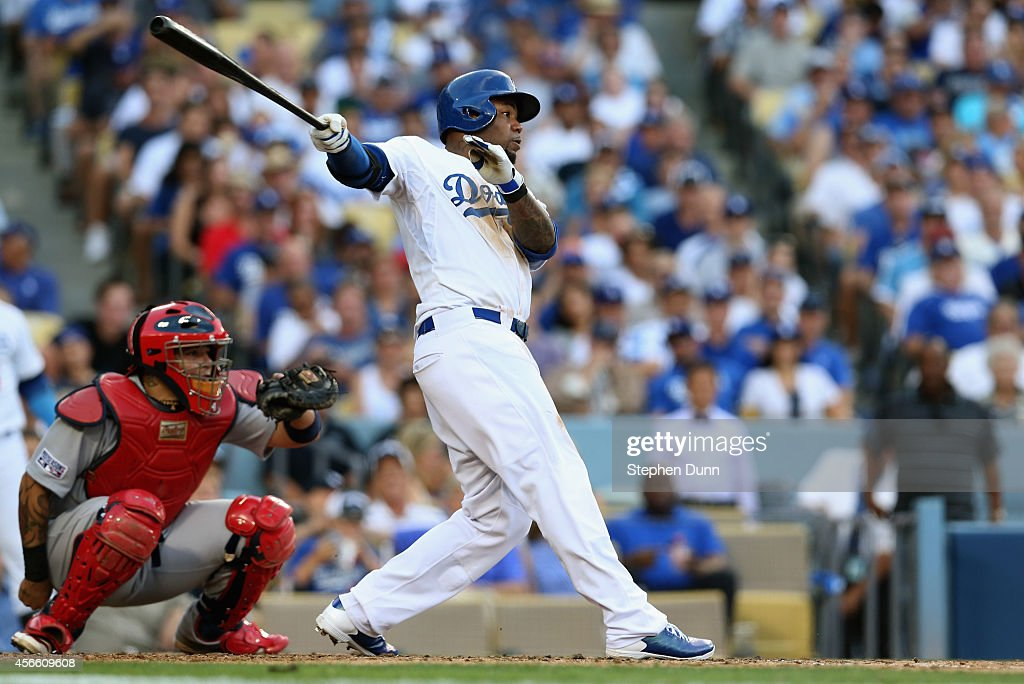 <a gi-track='captionPersonalityLinkClicked' href=/galleries/search?phrase=Carl+Crawford&family=editorial&specificpeople=208074 ng-click='$event.stopPropagation()'>Carl Crawford</a> #3 of the Los Angeles Dodgers hits a lead outfield single in the fifth inning against the St. Louis Cardinals during Game One of the National League Division Series at Dodger Stadium on October 3, 2014 in Los Angeles, California.