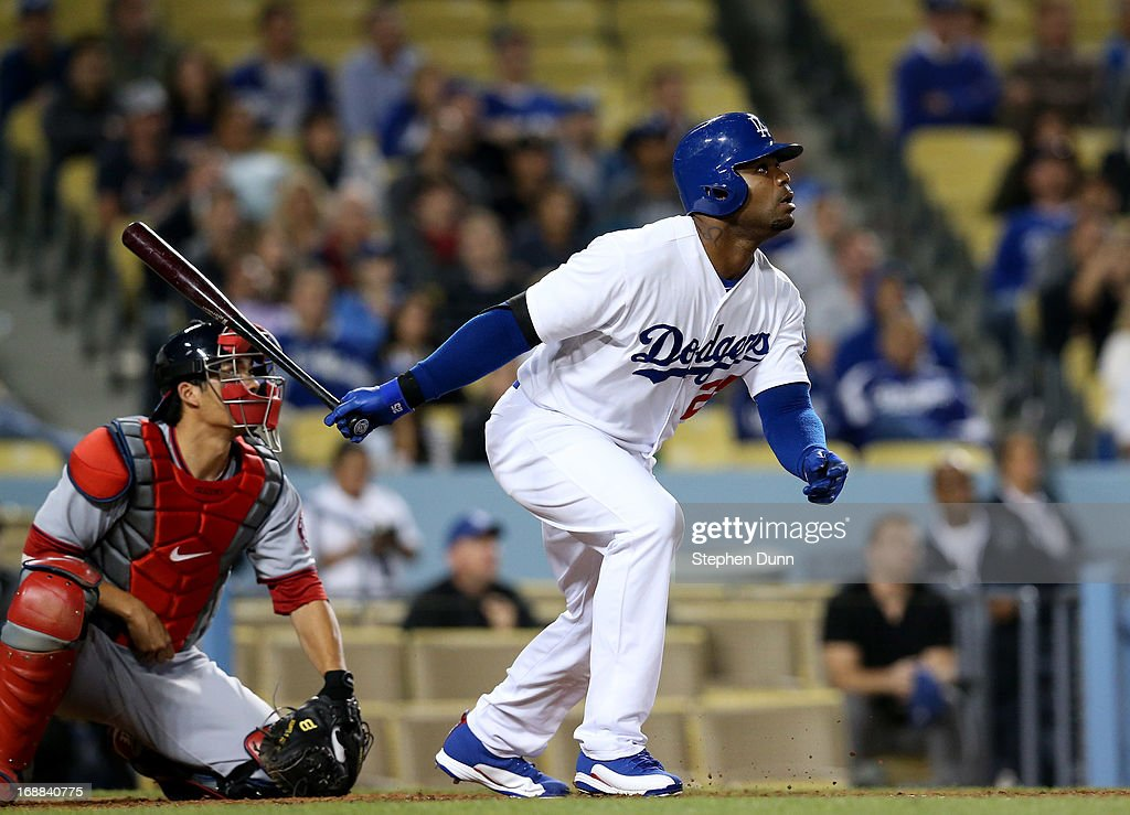 <a gi-track='captionPersonalityLinkClicked' href=/galleries/search?phrase=Carl+Crawford&family=editorial&specificpeople=208074 ng-click='$event.stopPropagation()'>Carl Crawford</a> #25 of the Los Angeles Dodgers hits a sacrifice fly to give the Dodgers a two run lead in the eighth inning against the Washington Nationals at Dodger Stadium on May 15, 2013 in Los Angeles, California.