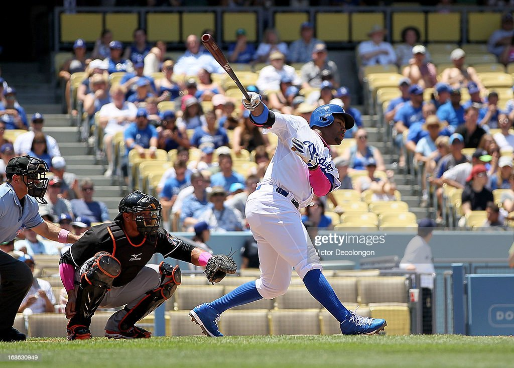 Carl Crawford #25 of the Los Angeles Dodgers hits an infield single to first base in the first inning against the Miami Marlins during the MLB game at Dodger Stadium on May 12, 2013 in Los Angeles, California. The Dodgers defeated the Marlins 5-3.