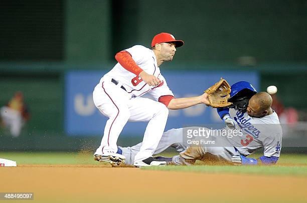 Carl Crawford of the Los Angeles Dodgers is tagged out trying to steal second base in the seventh inning by Danny Espinosa of the Washington...