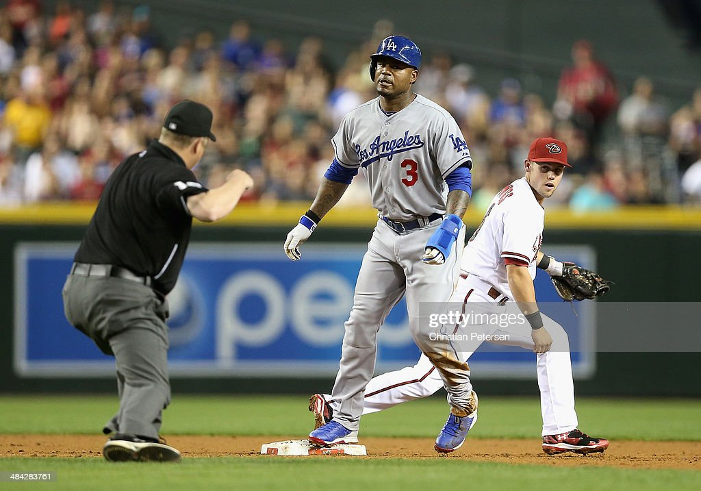 <a gi-track='captionPersonalityLinkClicked' href=/galleries/search?phrase=Carl+Crawford&family=editorial&specificpeople=208074 ng-click='$event.stopPropagation()'>Carl Crawford</a> #3 of the Los Angeles Dodgers reacts after being forced out at second base by infielder Chris Owings #16 of the Arizona Diamondbacks during the MLB game at Chase Field on April 11, 2014 in Phoenix, Arizona. The Dodgers defeated the Diamondbacks 6-0.