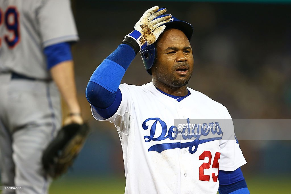 Carl Crawford #25 of the Los Angeles Dodgers reacts to getting thrown out on first base by Dillon Gee #35 of the New York Mets while leading off the base during the game against the New York Mets at Dodger Stadium on August 14, 2013 in Los Angeles, California.