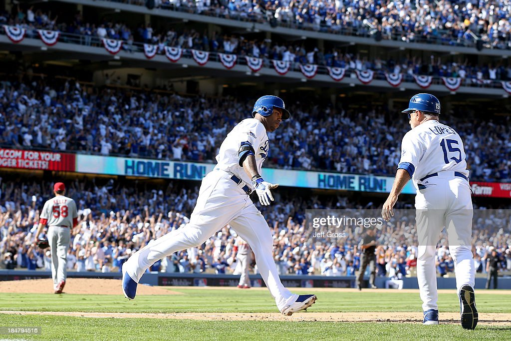 Carl Crawford #25 of the Los Angeles Dodgers rounds the bases after hitting a solo home run in the fifth inning off of Joe Kelly #58 of the St. Louis Cardinals in Game Five of the National League Championship Series at Dodger Stadium on October 16, 2013 in Los Angeles, California.