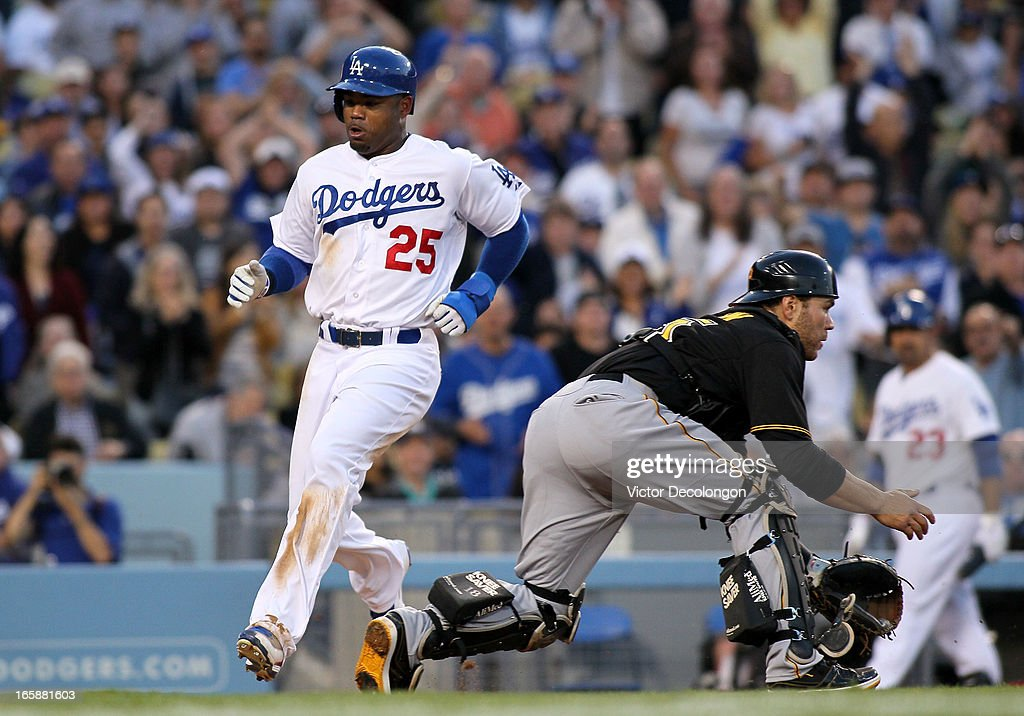 <a gi-track='captionPersonalityLinkClicked' href=/galleries/search?phrase=Carl+Crawford&family=editorial&specificpeople=208074 ng-click='$event.stopPropagation()'>Carl Crawford</a> #25 of the Los Angeles Dodgers scores on a single to left field by Mark Ellis #14 (not in photo) as catcher <a gi-track='captionPersonalityLinkClicked' href=/galleries/search?phrase=Russell+Martin+-+Baseball+Player&family=editorial&specificpeople=13764024 ng-click='$event.stopPropagation()'>Russell Martin</a> #55 of the Pittsburgh Pirates waits for the ball in the third inning against during the MLB game at Dodger Stadium on April 6, 2013 in Los Angeles, California.