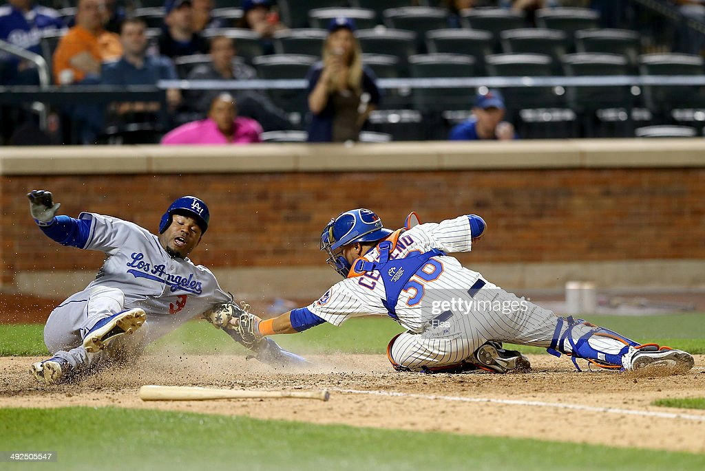 Carl Crawford #3 of the Los Angeles Dodgers slides home safely in the ninth inning as Juan Centeno #36 of the New York Mets misses the tag on May 20, 2014 at Citi Field in the Flushing neighborhood of the Queens borough of New York City.