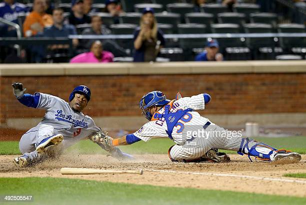 Carl Crawford of the Los Angeles Dodgers slides home safely in the ninth inning as Juan Centeno of the New York Mets misses the tag on May 20 2014 at...