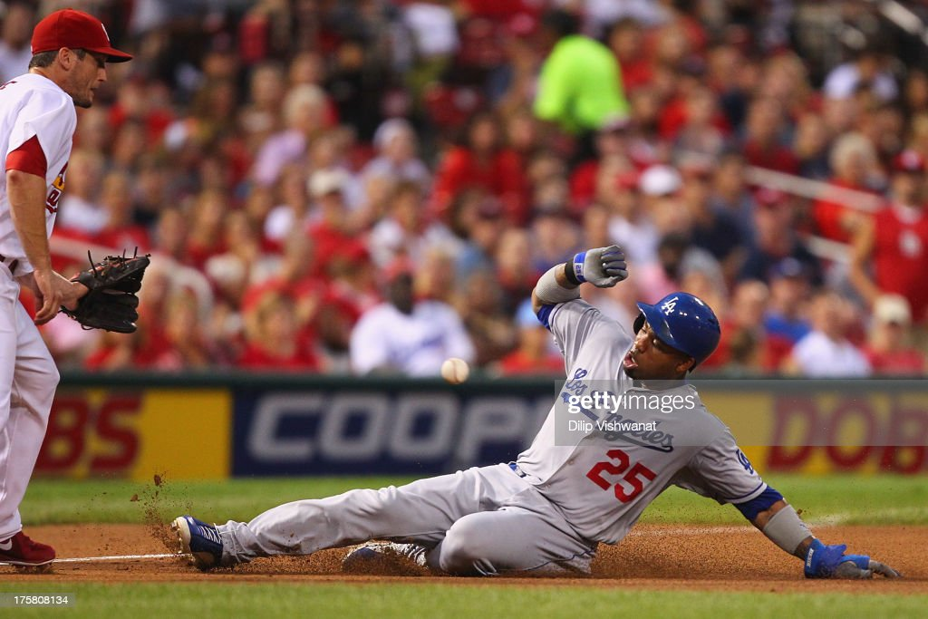 <a gi-track='captionPersonalityLinkClicked' href=/galleries/search?phrase=Carl+Crawford&family=editorial&specificpeople=208074 ng-click='$event.stopPropagation()'>Carl Crawford</a> #25 of the Los Angeles Dodgers slides safely into third base against <a gi-track='captionPersonalityLinkClicked' href=/galleries/search?phrase=David+Freese+-+Baseball+Player&family=editorial&specificpeople=4948315 ng-click='$event.stopPropagation()'>David Freese</a> #23 of the St. Louis Cardinals in the first inning at Busch Stadium on August 8, 2013 in St. Louis, Missouri.