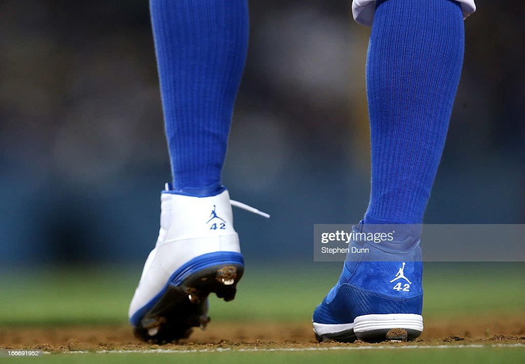 <a gi-track='captionPersonalityLinkClicked' href=/galleries/search?phrase=Carl+Crawford&family=editorial&specificpeople=208074 ng-click='$event.stopPropagation()'>Carl Crawford</a> of the Los Angeles Dodgers wears one blue shoe and one white shoe, both with Jacke Robinson's number 42 on the back, as he stands on first base in the game against the San Diego Padres at Dodger Stadium on April 15, 2013 in Los Angeles, California. All uniformed team members are wearing jersey number 42 in honor of Jackie Robinson Day.