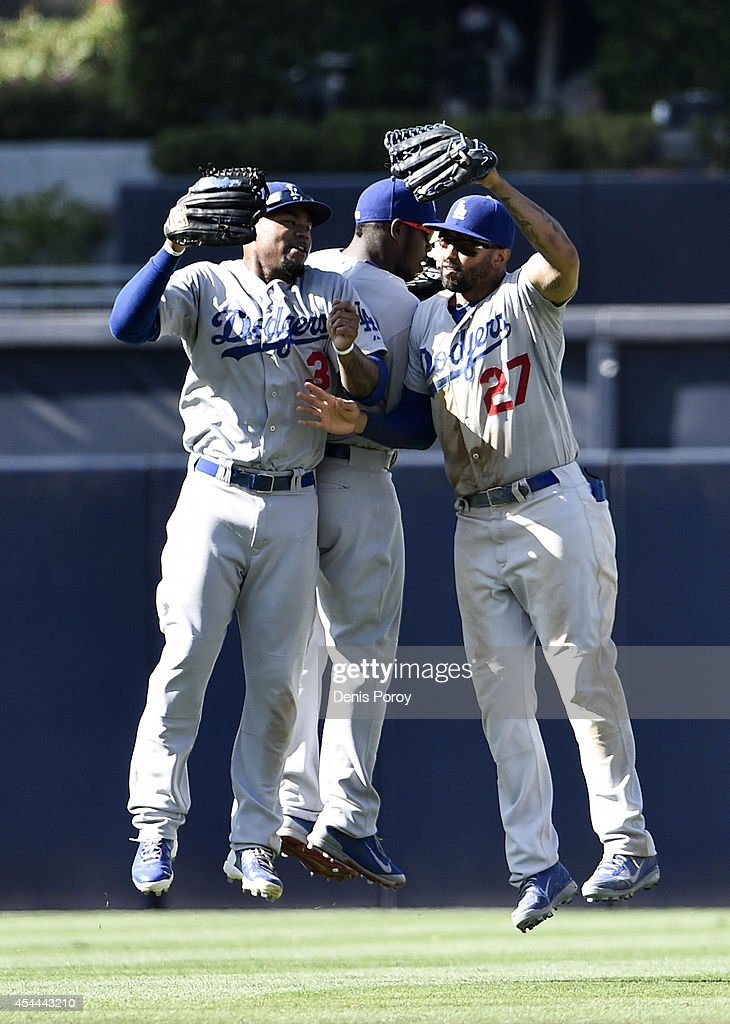 <a gi-track='captionPersonalityLinkClicked' href=/galleries/search?phrase=Carl+Crawford&family=editorial&specificpeople=208074 ng-click='$event.stopPropagation()'>Carl Crawford</a> #3 of the Los Angeles Dodgers, <a gi-track='captionPersonalityLinkClicked' href=/galleries/search?phrase=Yasiel+Puig&family=editorial&specificpeople=10484087 ng-click='$event.stopPropagation()'>Yasiel Puig</a> #66 and <a gi-track='captionPersonalityLinkClicked' href=/galleries/search?phrase=Matt+Kemp&family=editorial&specificpeople=567161 ng-click='$event.stopPropagation()'>Matt Kemp</a> #27 celebrate after beating the San Diego Padres 7-1 in a baseball game at Petco Park August, 31, 2014 in San Diego, California.