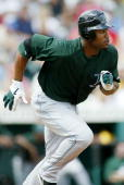Carl Crawford of the Tampa Bay Devil Rays runs a base during the game against the Pittsburgh Pirates on March 12 2006 at McKechnie Field in Bradenton...