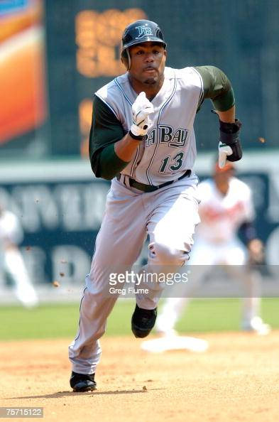 Carl Crawford of the Tampa Bay Devil Rays steals third base against the Baltimore Orioles at Camden Yards July 26 2007 in Baltimore Maryland