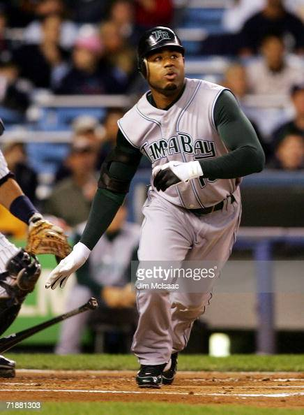 Carl Crawford of the Tampa Bay Devil Rays watches his first inning home run against the New York Yankees on September 13 2006 at Yankee Stadium in...