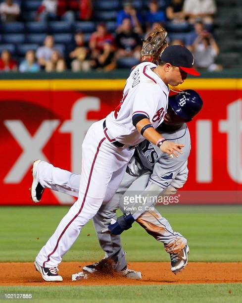 Carl Crawford of the Tampa Bay Rays slides safely into second base under the tag of Martin Prado of the Atlanta Braves at Turner Field on June 15...