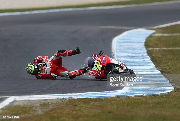 Carl Crutchlow of Great Britain riding the Ducati Team Ducati crashes out during the 2014 MotoGP of Australia at Phillip Island Grand Prix Circuit on...