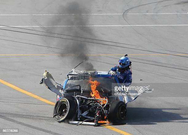 Carl Edwards climbs from the Claritin Ford after suffering damage at the conclusion of the NASCAR Sprint Cup Series Aaron's 499 at Talladega...
