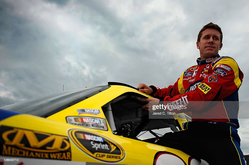 <a gi-track='captionPersonalityLinkClicked' href=/galleries/search?phrase=Carl+Edwards&family=editorial&specificpeople=193803 ng-click='$event.stopPropagation()'>Carl Edwards</a> climbs from the #99 Kellogg's Ford after qualifying for the NASCAR Sprint Cup Series Pocono 400 presented by #NASCAR at Pocono Raceway on June 9, 2012 in Long Pond, Pennsylvania.