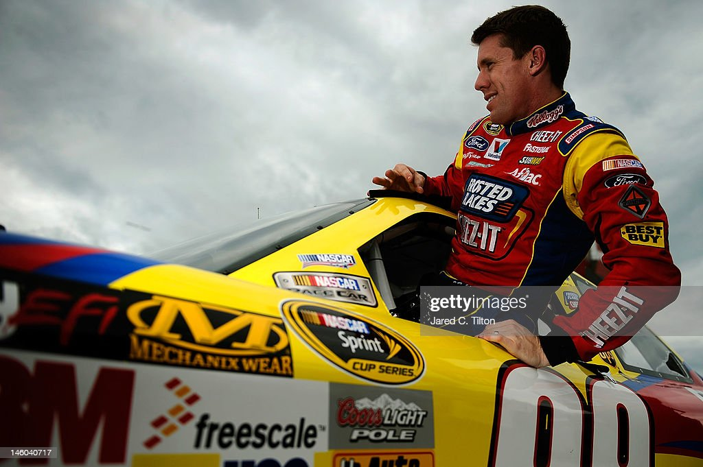 <a gi-track='captionPersonalityLinkClicked' href=/galleries/search?phrase=Carl+Edwards+-+Racecar+Driver&family=editorial&specificpeople=193803 ng-click='$event.stopPropagation()'>Carl Edwards</a> climbs from the #99 Kellogg's Ford after qualifying for the NASCAR Sprint Cup Series Pocono 400 presented by #NASCAR at Pocono Raceway on June 9, 2012 in Long Pond, Pennsylvania.