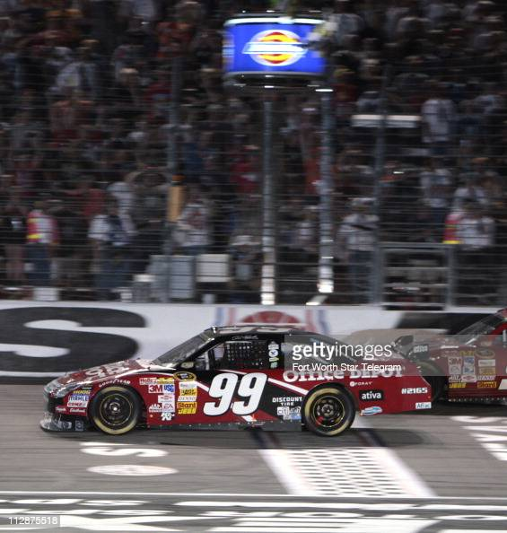 Carl Edwards crosses the finishes line to win the NASCAR Sprint Cup Dickies 500 race on Sunday November 2 at Texas Motor Speedway in Fort Worth Texas