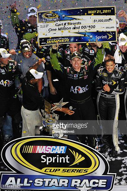 Carl Edwards driver of the Aflac Ford celebrates after winning the NASCAR Sprint AllStar Race at Charlotte Motor Speedway on May 21 2011 in Charlotte...