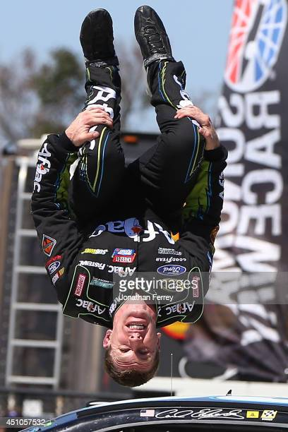 Carl Edwards driver of the Aflac Ford celebrates with a backflip after winning the NASCAR Sprint Cup Series Toyota/Save Mart 350 at Sonoma Raceway on...