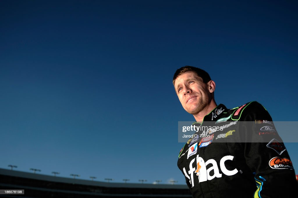 <a gi-track='captionPersonalityLinkClicked' href=/galleries/search?phrase=Carl+Edwards+-+Racecar+Driver&family=editorial&specificpeople=193803 ng-click='$event.stopPropagation()'>Carl Edwards</a>, driver of the #99 Aflac Ford, climbs from his car on the grid during qualifying for the NASCAR Sprint Cup Series AAA Texas 500 at Texas Motor Speedway on November 1, 2013 in Fort Worth, Texas.