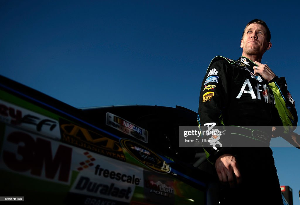 Carl Edwards, driver of the #99 Aflac Ford, climbs from his car on the grid during qualifying for the NASCAR Sprint Cup Series AAA Texas 500 at Texas Motor Speedway on November 1, 2013 in Fort Worth, Texas.