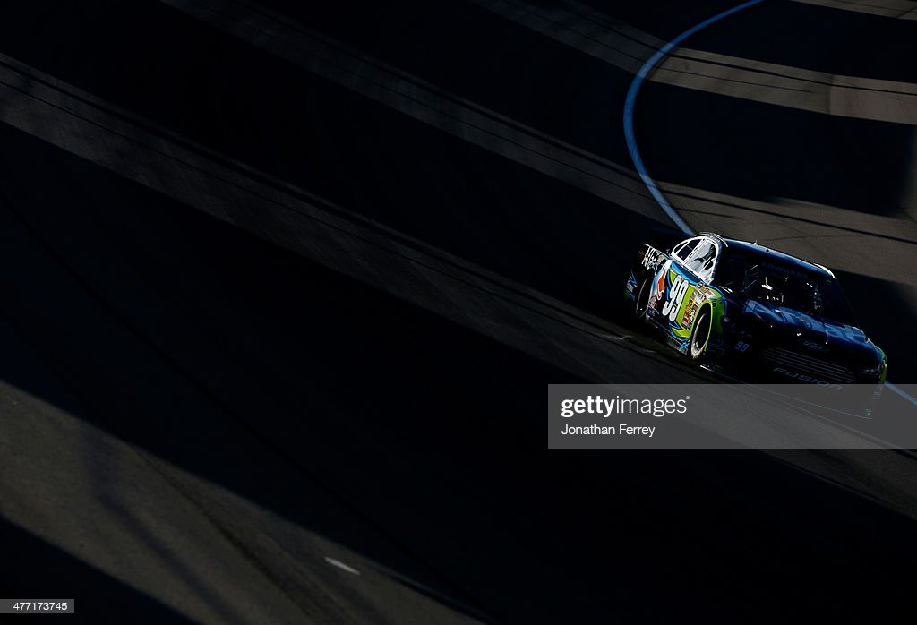 Carl Edwards, driver of the #99 Aflac Ford, drives during qualifying for the NASCAR Sprint Cup Series Kobalt 400 at Las Vegas Motor Speedway on March 7, 2014 in Las Vegas, Nevada.