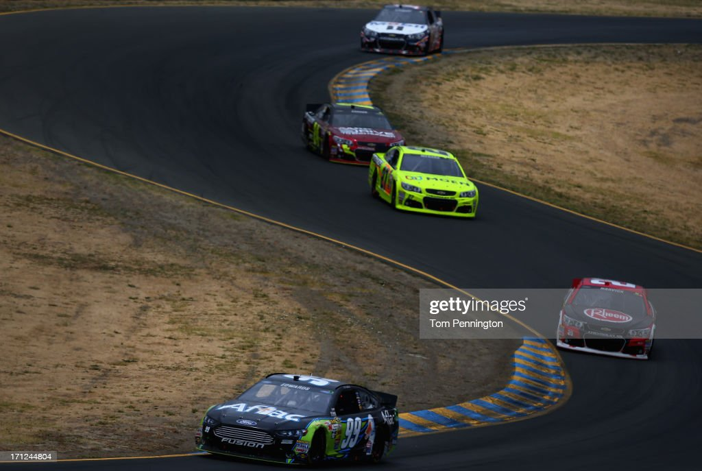 Carl Edwards, driver of the #99 Aflac Ford, leads a pack of cars during the NASCAR Sprint Cup Series Toyota/Save Mart 350 at Sonoma Raceway on June 23, 2013 in Sonoma, California.