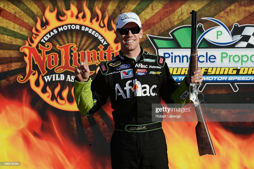 <a gi-track='captionPersonalityLinkClicked' href=/galleries/search?phrase=Carl+Edwards&family=editorial&specificpeople=193803 ng-click='$event.stopPropagation()'>Carl Edwards</a>, driver of the #99 Aflac Ford, poses with the Rifle Pole Award after qualifying for pole position for the NASCAR Sprint Cup Series AAA Texas 500 at Texas Motor Speedway on November 1, 2013 in Fort Worth, Texas.