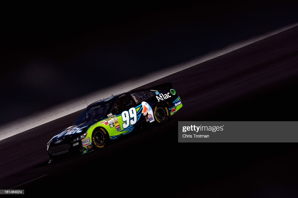 <a gi-track='captionPersonalityLinkClicked' href=/galleries/search?phrase=Carl+Edwards&family=editorial&specificpeople=193803 ng-click='$event.stopPropagation()'>Carl Edwards</a>, driver of the #99 Aflac Ford, practices for the NASCAR Sprint Cup Series Sylvania 300 at New Hampshire Motor Speedway on September 21, 2013 in Loudon, New Hampshire.