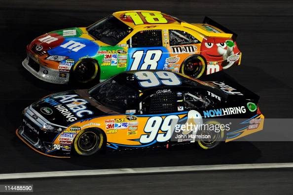 Carl Edwards driver of the Aflac Ford races Kyle Busch driver of the MM's Toyota during the NASCAR Sprint AllStar Race at Charlotte Motor Speedway on...