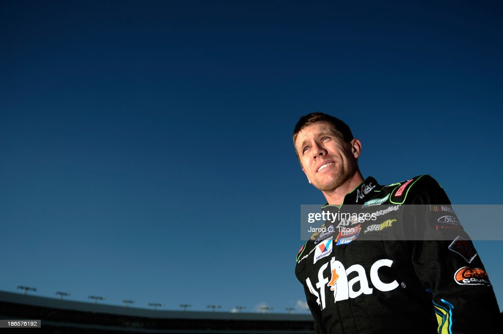 <a gi-track='captionPersonalityLinkClicked' href=/galleries/search?phrase=Carl+Edwards+-+Racecar+Driver&family=editorial&specificpeople=193803 ng-click='$event.stopPropagation()'>Carl Edwards</a>, driver of the #99 Aflac Ford, stands on the grid during qualifying for the NASCAR Sprint Cup Series AAA Texas 500 at Texas Motor Speedway on November 1, 2013 in Fort Worth, Texas.