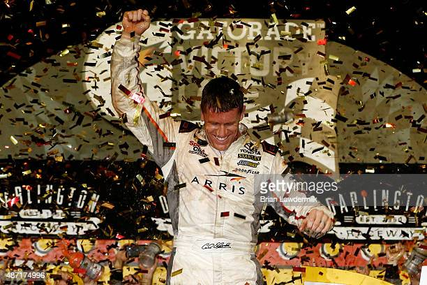 Carl Edwards driver of the ARRIS Toyota celebrates in Victory Lane after winning the NASCAR Sprint Cup Series Bojangles' Southern 500 at Darlington...