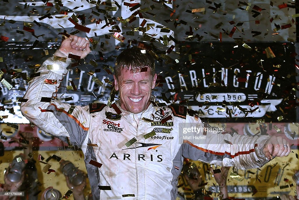 <a gi-track='captionPersonalityLinkClicked' href=/galleries/search?phrase=Carl+Edwards&family=editorial&specificpeople=193803 ng-click='$event.stopPropagation()'>Carl Edwards</a>, driver of the #19 ARRIS Toyota, celebrates in Victory Lane after winning the NASCAR Sprint Cup Series Bojangles' Southern 500 at Darlington Raceway on September 6, 2015 in Darlington, South Carolina.