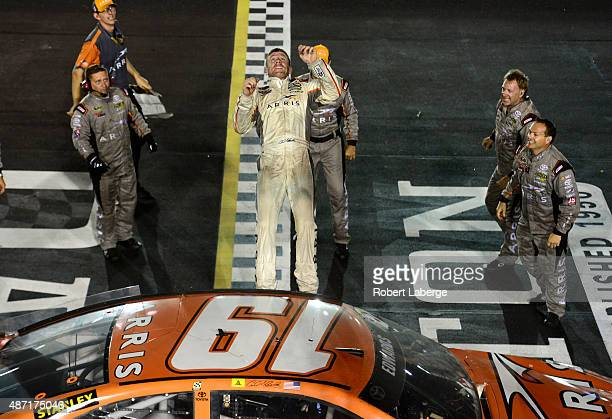 Carl Edwards driver of the ARRIS Toyota celebrates with a backflip after winning the NASCAR Sprint Cup Series Bojangles' Southern 500 at Darlington...